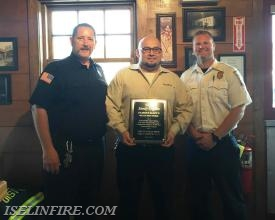 Thank you plaque presented to Famous Dave's Store Manager Sandy Urgilez by FF Kevin Williams (L) and Chief Joe Geary (R).