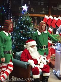 Santa Claus with elves Christian Pirozzoli and Matt Murdoch.