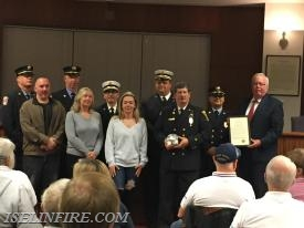 Brian Bennett with the Kolarick Family (left), Mayor John McCormac (right), and members of the Keasbey Fire Department.