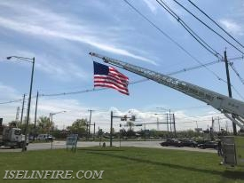Truck 9-2-4 Displaying the American Flag at the corner of Green Street and Route 1 South.