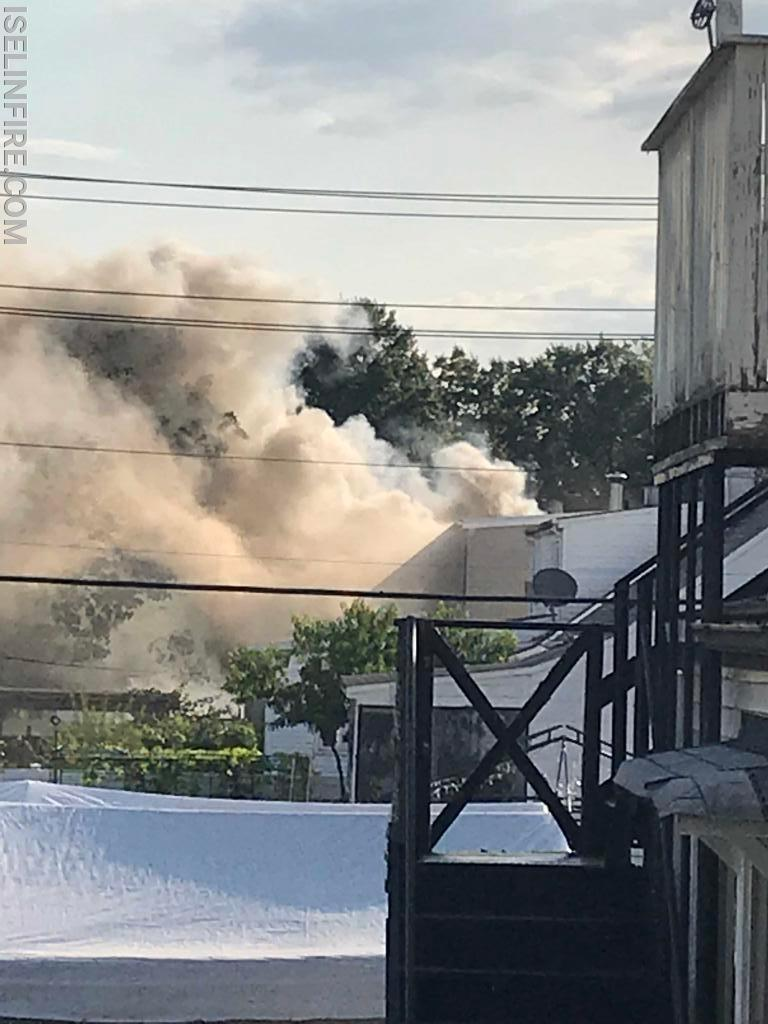 Smoke seen exiting the rear of the house.