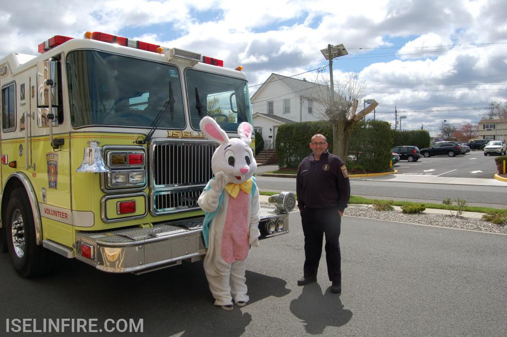 The Easter Bunny talks with Chief McPartland before driving through the fire district.